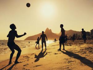 People playing football at Ipanema Beach in Rio