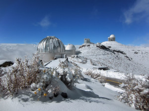 Snow dusts the La Silla Observatory and its family of telescopes in this icy image. The MPG/ESO 2.2-metre telescope, the ESO 1-metre Schmidt telescope, the New Technology Telescope (NTT) and the ESO 3.6-metre telescope can be seen from left to right. Despite being located on the Southern outskirts of the arid Atacama Desert — one of the driest areas on Earth — these telescopes in northern Chile occasionally see snowfall.